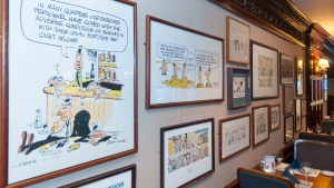 Crock cartoons hanging on the wall of the Reliable Source.