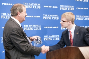 Don L. Blankenship, chairman and chief executive officer of Massey Energy Company, accepts the traditional NPC coffee mug from president, Alan Bjerga at a July 22, 2010 National Press Club...