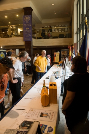 Members and runners peruse silent auction items, with proceeds going to the Eric Friedheim National Journalism Library.