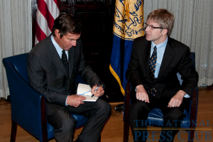 Actor Dennis Quaid signs the guestbook before his luncheon address at the National Press Club.Photo: Al Teich
