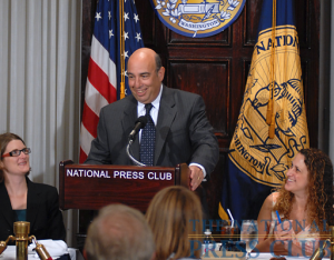 Robert Herz, chairman of the Financial Accounting Standards Board, enjoys a lighter moment at the Press Club Luncheon on June 26, 2009, with Angela Greiling Keane (left of podium), reporter...