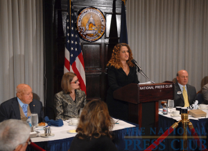 NPC President Donna Leinwand of USAToday (podium) introduces Chick-fil-A Inc. Founder/Chairman Truett Cathy (far left) and Chick-fil-A President/CEO Dan Cathy (right) at a National Press Club Speakers Series luncheon, as...