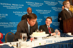 Dennis Quaid blows out the candles on his birthday cake as NPC speakers committee chairman Andrew Schneider looks on.Photo: Al Teich