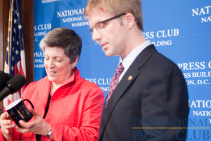Janet Napolitano, secretary of the Department of Homeland Security, accepts the traditional NPC Coffee Mug from President Alan Bjerga. Ms. Napolitano addressed the National Press Club at an April 15...