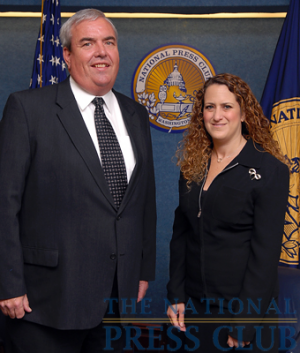 NPC President Donna Leinwand of USAToday welcomes John Potter, Postmaster General of the United States Postal Service, to the National Press Club.Photo: Gregory Tinius