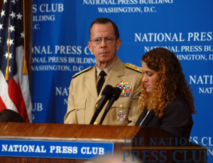 Adm. Mike Mullen, Chairman of the Joint Chiefs of Staff, listens as NPC President Donna Leinwand of USAToday poses questions from the audience at a Press Club Luncheon on July...