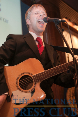 "Following the formal dinner, NPC's newest president, Alan Bjerga of Bloomberg News, joined Honky Tonk Confidential onstage. Mr. Bjerga delivered an excited rendition of Bruce Sprinsteen's ""Born to Run"" at..."