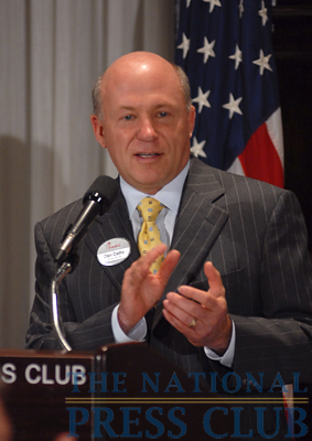 Chick-fil-A President/CEO Dan Cathy salutes company employees on hand at a National Press Club Speakers Series luncheon.Photo: Gregory Tinius