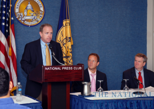 Mark Schoeff Jr., chair, NPC Newsmakers Committee, introduces Timothy A. Franklin (far right), director of the National Sports Journalism Center at Indiana University and former editor of The Baltimore Sun...