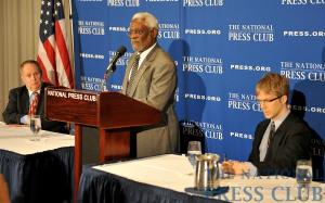 Myron Belkind, left, and Alan Bjerga, right, listen as Ambassador Raymond Joseph speaks about the current state of Haiti.Photo: Ben Keller