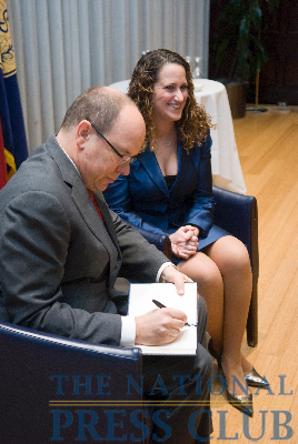 NPC President Donna Leinwand observes as HSH Prince Albert II of Monaco, Marquis of Baux, signs the National Press Club Guest Book at a luncheon event, November 30th, 2009.Photo: Noel...
