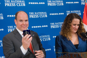 Prince Albert mugs with his mug after accepting the traditional gift from NPC president, Donna Leinwand at a National Press Club Luncheon, November 30th, 2009.Photo: Noel St. John