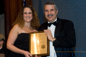 Author and New York Times Columnist, Thomas Friedman accepts the Fourth Estate Award from NPC President, Donna Leinwand.Photo: Noel St. John