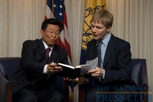Captain Jiafu Wei, President and CEO of COSCO, signs the NPC Guestbook for NPC Vice President, Alan Bjerga.Photo: Noel St. John