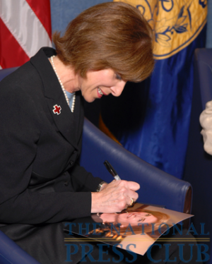 Gail McGovern, President and CEO of the American Red Cross, signs her photograph for the wall of the Press Club before a Press Club Luncheon on July 21, 2009.Photo: Gregory...