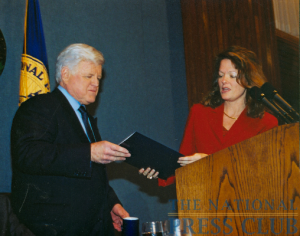 The Senator holds the famous Press Club mug presented by NPC president Tammy Lytle, January 21, 2003.Photo: Art GarrisonDate: January 21, 2003