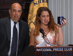 NPC President Donna Leinwand of USA Today presents Robert Herz, chairman of the Financial Accounting Standards Board, with th traditional Press Club Mug at the Press Club Luncheon on June...