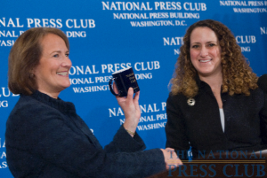 Karen Mills, head of the U.S. Small Business Administration, accepts the tradition National Press Club coffee mug from NPC President, Donna Leinwand.Photo: Noel St. John