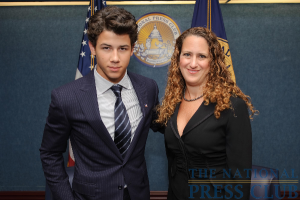 Teen music superstar Nick Jonas and National Press Club President Donna Leinwand at an August 24 NPC Luncheon.Photo: Sam Hurd