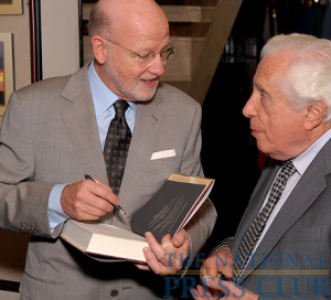 "John Maxwell Hamilton autographs a copy of of ""Journalism's Roving Eye: A History of American Foreign Reporting"" for Seymour Topping, former New York Times foreign correspondent and Managing Editor, at..."
