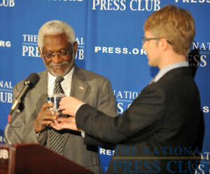 Alan Bjerga, right, presents Haitian Ambassador Raymond Joseph with a National Press Club mug.Photo: Ben Keller