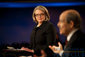 Margaret Spellings, Pres. and CEO, Margaret Spellings & Company; former Secretary of Education (left), listens as moderator Paul Solman speaks at a Miller Center Debate event, held Feb. 26, 2010...