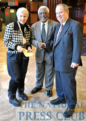 Event organizers Jan Du Plain, left, of the International Correspondents Committee, and Myron Belkind, right, of the Speaker's Committee, greet and welcome Haitian Ambassador Raymond Joseph to the National Press...