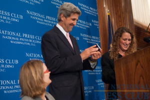 Senator John Kerry discusses climate change at a July 29 NPC luncheon. (L-R Angela Greiling-Keane, John Kerry, Donna Leinwand)Photo: Noel St. John