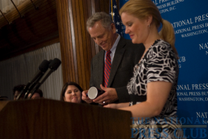 Morris Dees accepts the traditional Press Club coffee mug from Theresa Werner at the National Press Club. (L-R Melissa Charbonneau, Morris Dees, Theresa Werner).Photo: Noel St. John