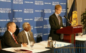 NPC President Alan Bjerga introduces Haitian Ambassador to the U.S. Raymond Joseph at a Feb. 11 Speakers Press Conference. (Also pictured: Myron Belkind, far left.)Photo: NPC