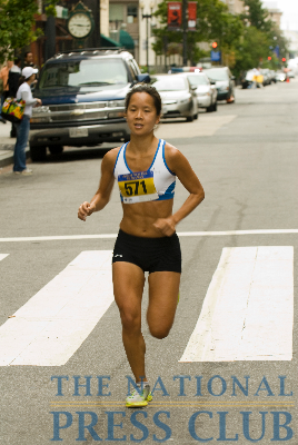 Phebe Ko, winner of the Ladies Division, races toward the finish line.Photo: Noel St. John