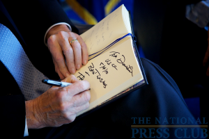 Thomas J. Donohue, President and CEO US Chamber of Commerce, and speaker for the National Press Club Luncheon, signs the visitors book.Photo: Michael Foley