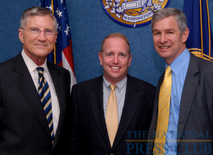 Mark Schoeff Jr., NPC Newsmakers Committee chair (center), welcomes Georgia State University's inaugural football Coach Bill Curry (left) and University President Mark Becker (right) to a September 23, 2009 Newsmaker...