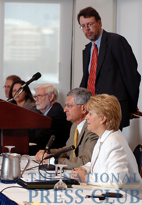 Paul Page (center) of the Journal of Commerce, moderates a panel discussion by The Freight Stakeholders Coalition at a National Press Club Newsmaker press conference September 14, 2009. Panel, left...
