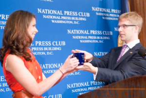 Barbara Bush accepts the traditional NPC coffee mug from President Alan Bjerga at a National Press Club Luncheon, May 26, 2010.Photo: Noel St. John
