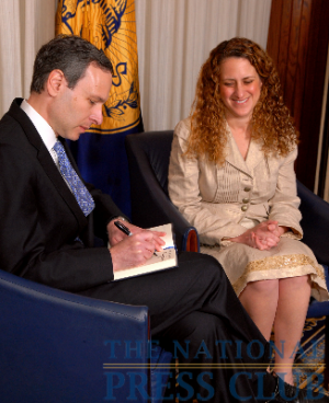 IRS Commissioner Douglas Shulman signs the traditional guest book with NPC President Donna Leinwand.Photo: Greg Tinius