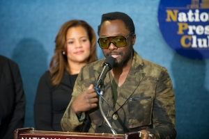 Artist Will.i.am addresses the media about green initiatives in the Club's Margaret Burke-White Room.