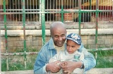 Jailed Ethiopian journalist Eskinder Nega, with his son, could receive the death penalty on May 11.