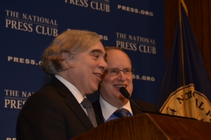 Secretary of Energy Ernest Moniz enjoys a light moment with NPC President Myron Belkind (right).