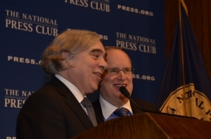 Secretary of Energy Ernest Moniz shares a light moment with past NPC President Myron Belkind in a 2014 appearance at the National Press Club.