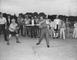 Nixon at bat at the NPC's Fourth Annual Family Frolic softball game in Rock Creek Park on June 15, 1958.