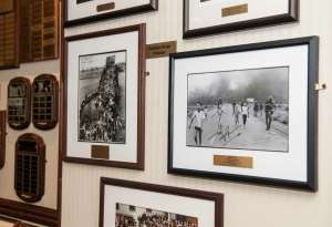 Nick Ut's Vietnam War Pulitzer-Prize photo, right, joins Max Desfor's Korean War Pulitzer photo, left, along with other Pulitzer prints, on the Club's wall.
