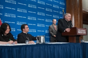 Archbishop Wenski leads a panel featuring Dr. Carolyn Woo (left) of Catholic Relief Services and Bishop Oscar Cantú (center left) of Las Cruces, New Mexico to discuss Pope Francis's pending visit to Washington, DC.  Club President John Hughes (center right) moderated the panel.