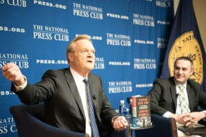 """Lawrence O'Donnell of MSNBC (left) talks about his latest book,  """"Playing with Fire: The 1968 Election and the Transformation of American Politics"""" at a National Press Club Headliners Book Rap, Dec. 13. He's joined on stage by 2016 Club President Thomas Burr, Washington Bureau Chief of the Salt Lake Tribune."""