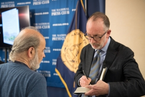 """Author Joseph Rodota signs a copy of his book """"The Watergate: Inside America's Most Infamous Address"""" for Watergate resident and Club guest Aron Primack before his Headliners Book Rap."""