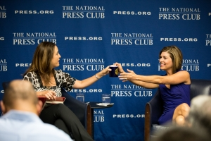 Sharyl Attkisson (right), former CBS News correspondent, spoke about her book at a National Press Club Headliners Book Rap on Aug. 31. Gifting her a Club coffee mug is moderator Betsy Fischer Martin (left), co-chair of the Club Headliners Committee.