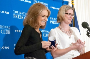 Feminist activist and founder of Ms. Magazine Gloria Steinem speaks at a National Press Club luncheon, November 18, 2013.  Ms. Steinem accepted the traditional coffee mug from NPC President Angela Greiling Keane.