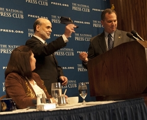 Federal Reserve Chairman and baseball fan Ben Bernanke shows off his new National Press Club cap.