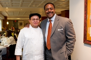 Leon Harris shows his trademark smile while thanking Assistant Executive Chef Moe Aguilera.